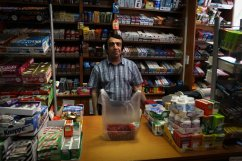 Buying Redcurrents and a Kinder Suprise, Berlin, Germany, 2012, by Mary Burks